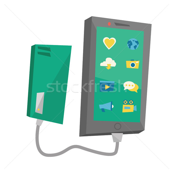 Reharging smartphone from portable battery. Stock photo © RAStudio