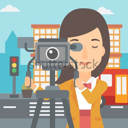 Camerawoman with movie camera on tripod. Stock photo © RAStudio