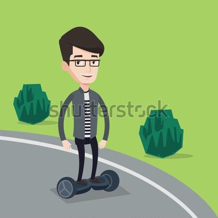 Man riding on self-balancing electric scooter. Stock photo © RAStudio