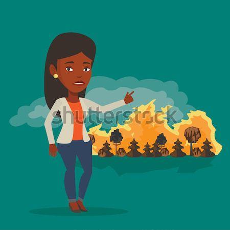 Kobieta stałego wildfire asian wskazując pożar lasu Zdjęcia stock © RAStudio