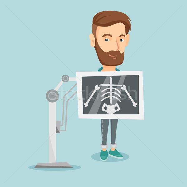 Paciente raio x jovem caucasiano homem Foto stock © RAStudio