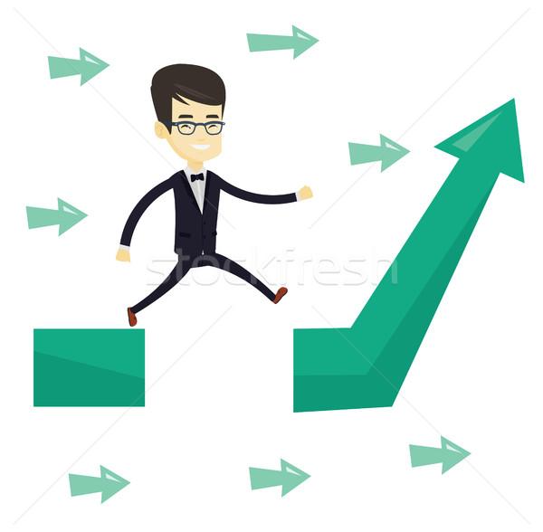 Business man jumping over gap on arrow going up. Stock photo © RAStudio