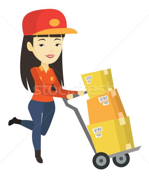 Consegna postino cartone scatole asian spingendo Foto d'archivio © RAStudio