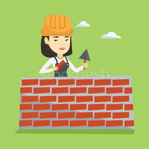 Murarz pracy cegły asian kobiet Zdjęcia stock © RAStudio