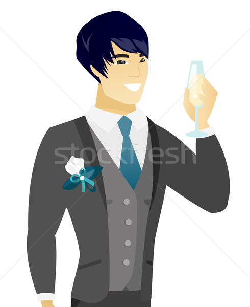 Young asian groom holding glass of champagne. Stock photo © RAStudio