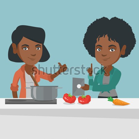 Men cooking healthy vegetable meal. Stock photo © RAStudio