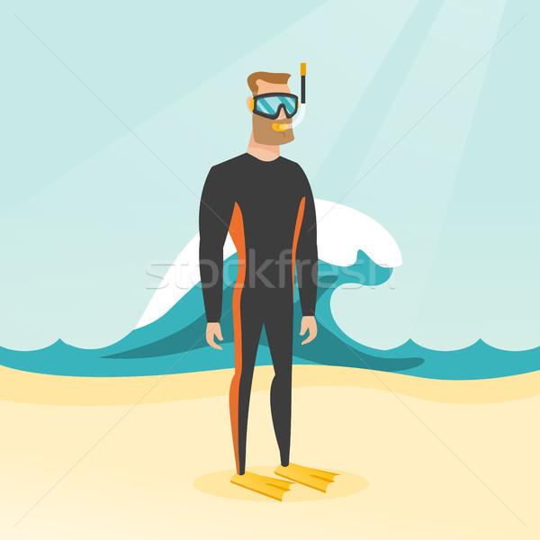 Young caucasian scuba diver in diving suit. Stock photo © RAStudio