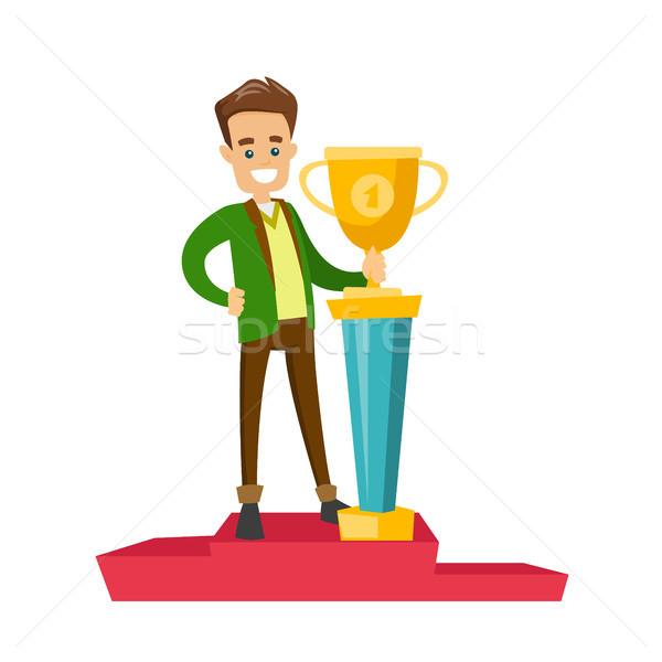 Man standing on the pedestal with business award. Stock photo © RAStudio