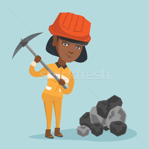 African miner in hard hat working with a pickaxe. Stock photo © RAStudio