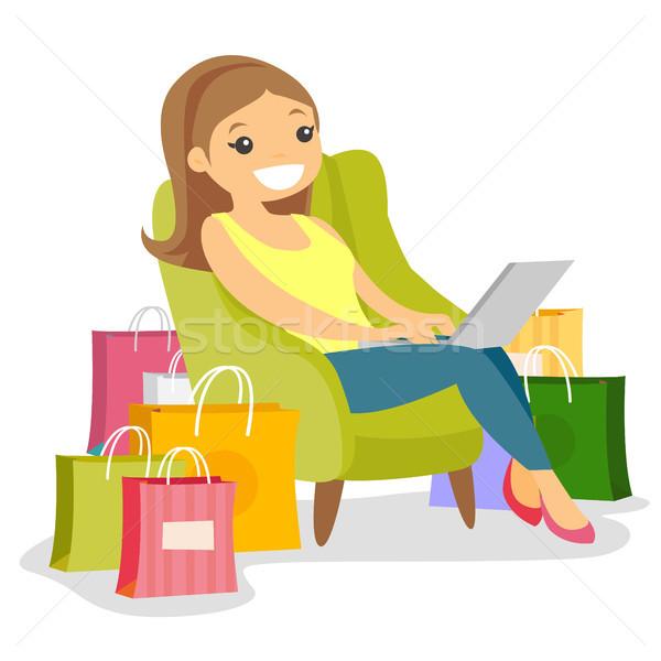 Caucasian woman using laptop for online shopping. Stock photo © RAStudio