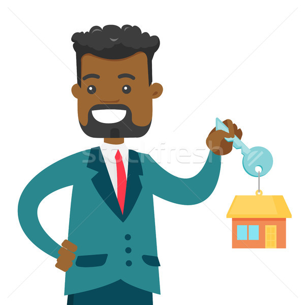 Young african owner holding key to his new house Stock photo © RAStudio