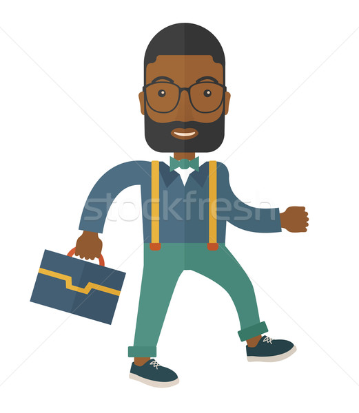 Young man walking with his briefcase. Stock photo © RAStudio