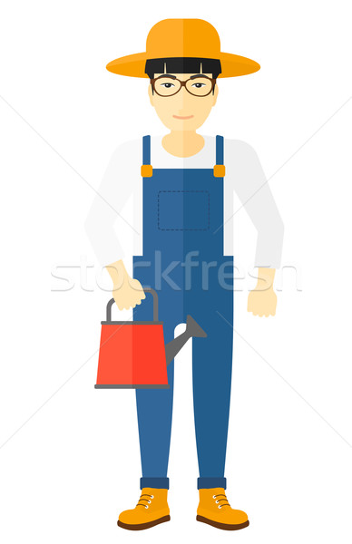 Farmer with watering can. Stock photo © RAStudio