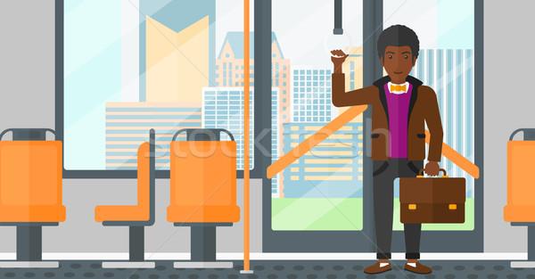 Adam ayakta içinde toplu taşıma bavul vektör Stok fotoğraf © RAStudio
