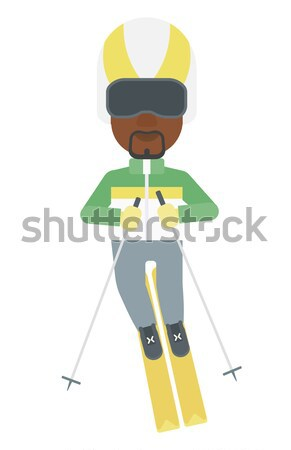 Stock photo: Young man skiing.