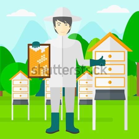 Bee-keeper at apiary. Stock photo © RAStudio