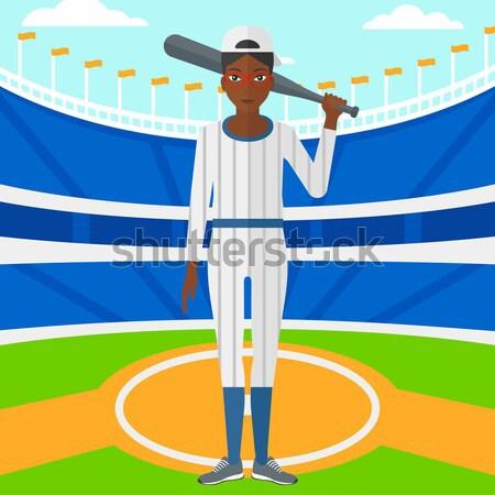 Jogador de beisebol bat jovem em pé beisebol estádio Foto stock © RAStudio