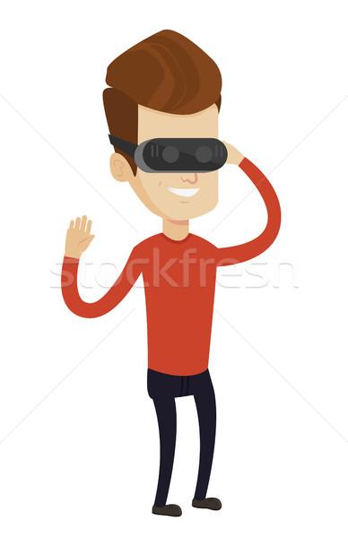 Man wearing virtual reality headset. Stock photo © RAStudio