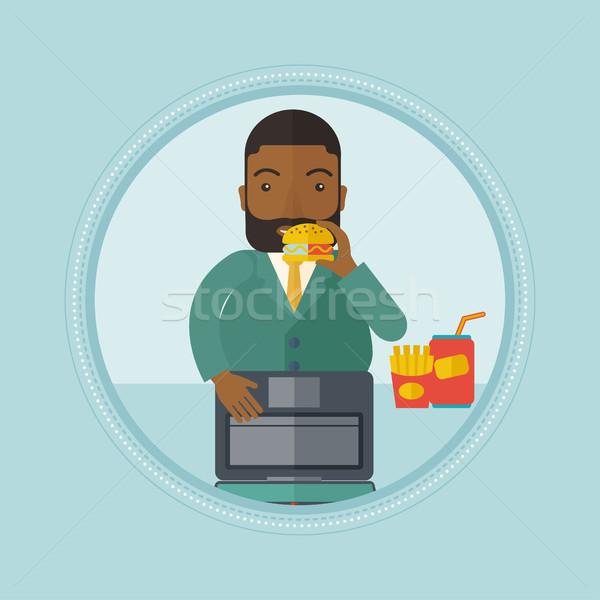 бизнесмен еды гамбургер человека рабочих ноутбука Сток-фото © RAStudio