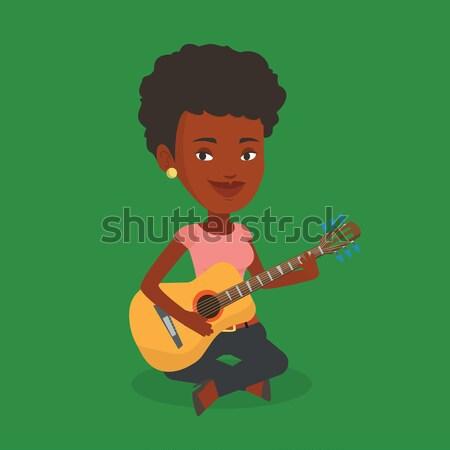 Nő játszik akusztikus gitár afrikai zenész ül Stock fotó © RAStudio