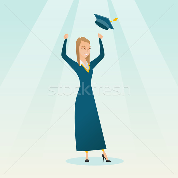 Graduate throwing up graduation hat. Stock photo © RAStudio