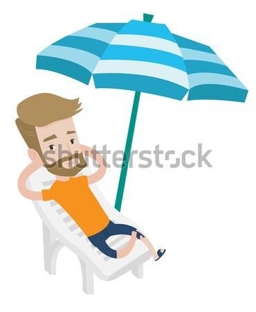 Adam rahatlatıcı şezlong oturma genç Stok fotoğraf © RAStudio