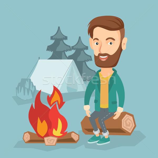 Homem sessão fogueira camping Foto stock © RAStudio