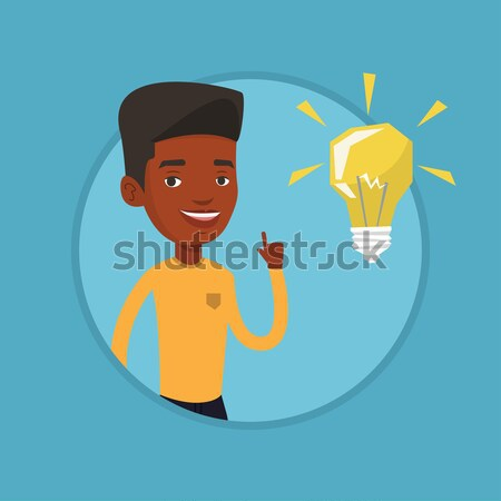 African-american builder pointing at light bulb. Stock photo © RAStudio
