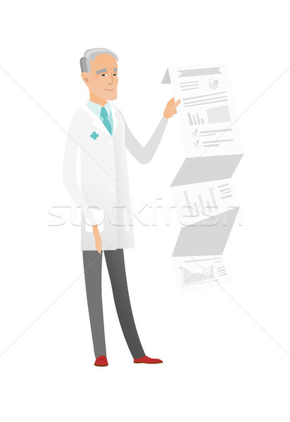 Senior doctor in medical gown giving presentation. Stock photo © RAStudio