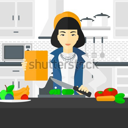 Domestic personal robot helps to owner at kitchen. Stock photo © RAStudio