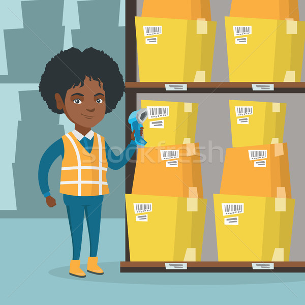 African warehouse worker scanning barcode on box. Stock photo © RAStudio