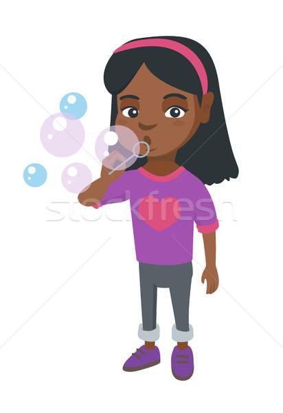 Peu fille bulles de savon jouer Photo stock © RAStudio