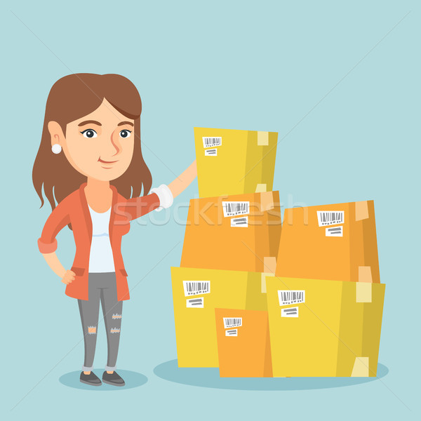 Young business woman checking boxes in warehouse. Stock photo © RAStudio
