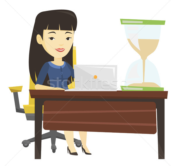 Asian business woman working in office. Stock photo © RAStudio