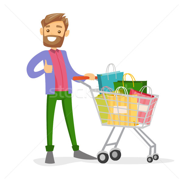 Young caucasian white man with shopping bags. Stock photo © RAStudio
