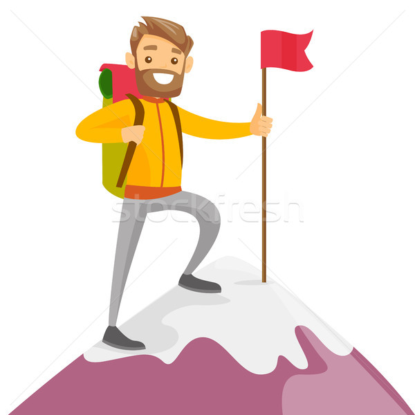 Young caucasian white man on the top of mountain. Stock photo © RAStudio