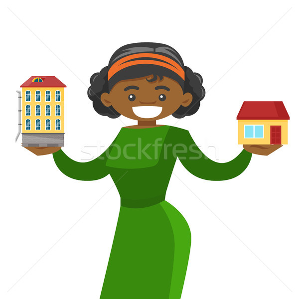 Woman choosing between town apartment and house. Stock photo © RAStudio