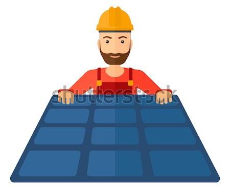 Constructor with solar panel. Stock photo © RAStudio