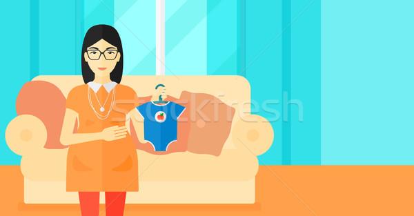 Zwangere vrouw kleding baby asian woonkamer Stockfoto © RAStudio