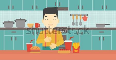 Man lijden maagzuur permanente keukentafel vol Stockfoto © RAStudio