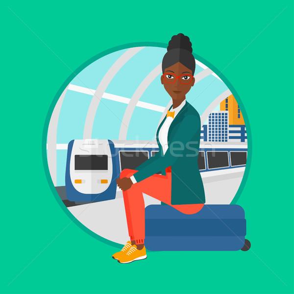 женщину сидят чемодан железнодорожная станция ждет Сток-фото © RAStudio