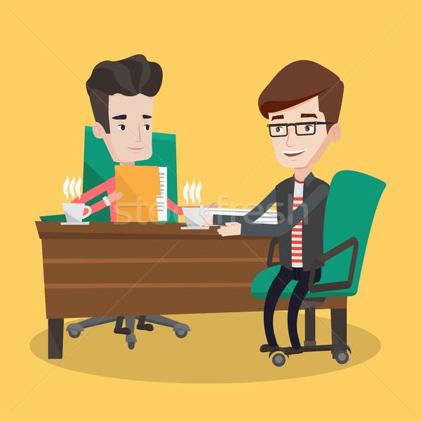 Two businessmen during business meeting. Stock photo © RAStudio