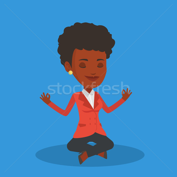 Stock photo: Business woman meditating in lotus position.