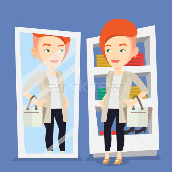 Woman trying on clothes in dressing room. Stock photo © RAStudio
