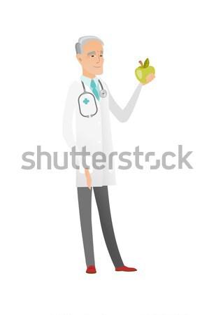 Caucasian nutritionist offering fresh red apple. Stock photo © RAStudio