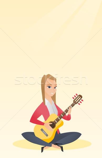 Kadın oynama akustik gitar kafkas müzisyen oturma Stok fotoğraf © RAStudio