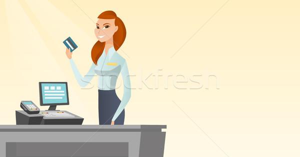 кавказский кассир кредитных карт улыбаясь Постоянный Сток-фото © RAStudio