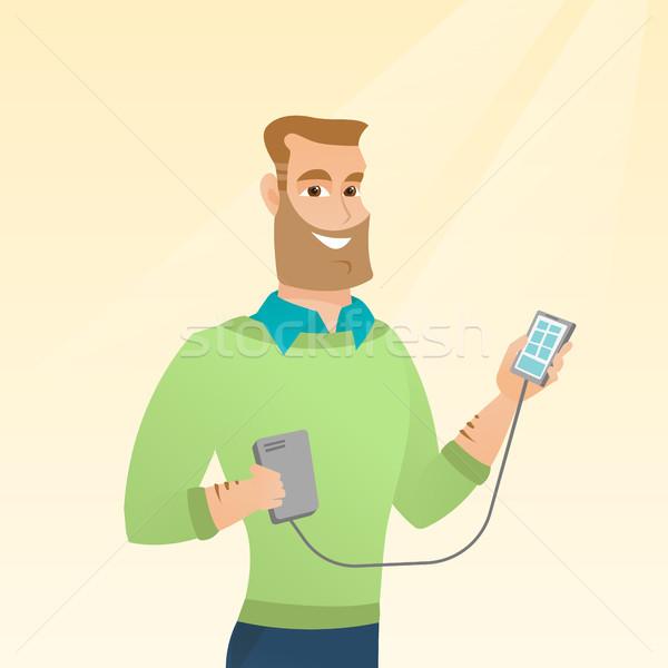 Férfi okostelefon hordozható elem fiatal kaukázusi Stock fotó © RAStudio