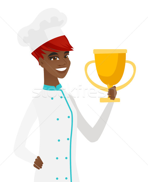 Young african-american chef holding a trophy. Stock photo © RAStudio