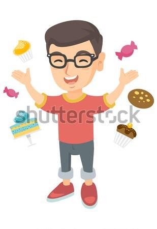 Happy caucasian boy standing among lots of sweets. Stock photo © RAStudio